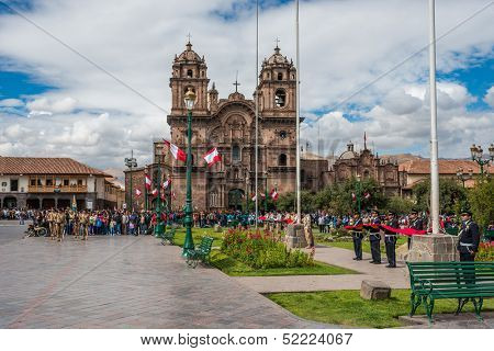 CUZCO, PERU - JULY 14: army parade in the Plaza de Armas at Cuzco Peru on july 14th, 2013. This plaza has been the scene of the proclamation by Francisco Pizarro in the conquest of Cuzco
