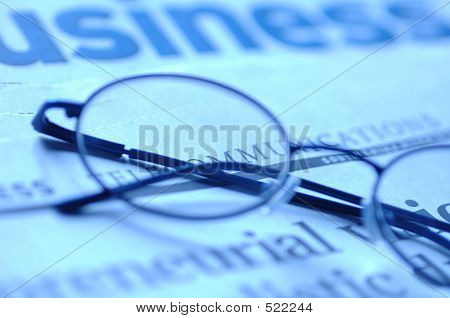 Newspaper With Glasses