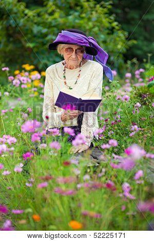 Stylish Senior Woman Reading Outdoors