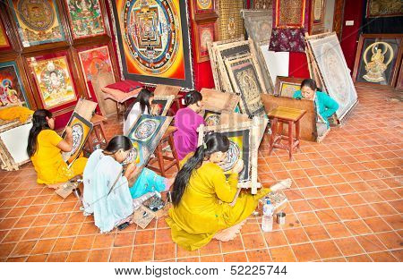BHAKTAPUR, NEPAL - MAY 20, 201 : Few students working in the classroom in Genuine Thanka painting school in Bhaktapur, Nepal on May 20, 2013. It is a high quality hand-panted Newari and Tibetan Art.