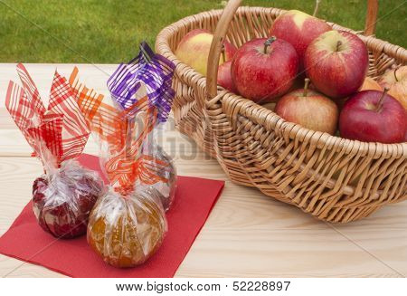 Caramel, Chocolate, Toffee And Fresh Red Apples On A Table.