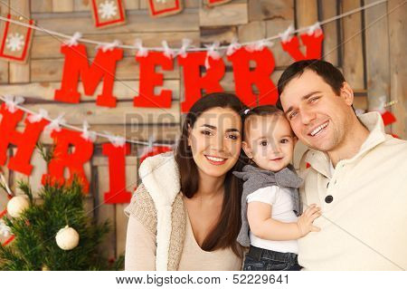 Happy Family With Near The Christmas Background