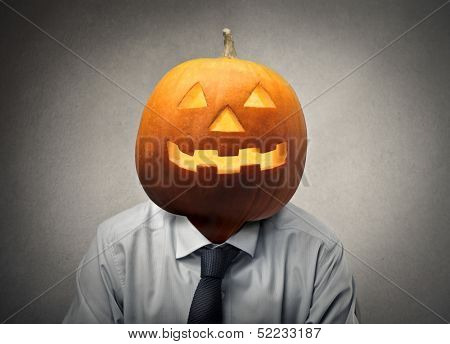 businessman with the head in the shape of Halloween pumpkin