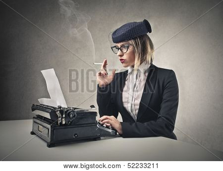 beautiful blonde woman writes with a typewriter
