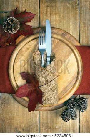 Autumn table setting with knife and fork