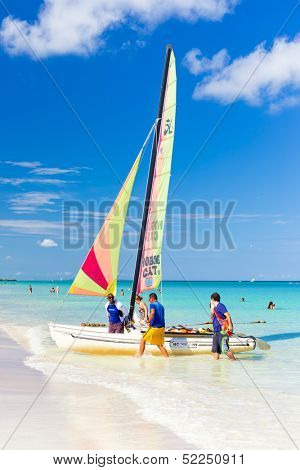 VARADERO,CUBA-OCTOBER 6:Tourists sailing on a catamaran October 6,2013 in Varadero.With over a million visitors per year,Varadero is the destination of more than 40% of tourists visiting the island