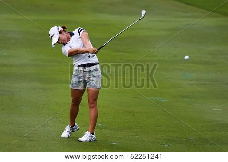 KUALA LUMPUR - OCTOBER 13: Mamiko Higa of Japan hits the ball to the 2nd hole green of the KLGCC course on the final day of the Sime Darby LPGA on October 13, 2013 in Kuala Lumpur, Malaysia.