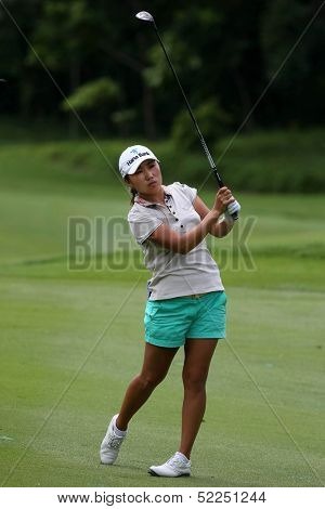 KUALA LUMPUR - OCTOBER 13: IK Kim of South Korea reacts after her shot to the 9th hole green on the final day of the Sime Darby LPGA tournament on October 13, 2013 in Kuala Lumpur, Malaysia.