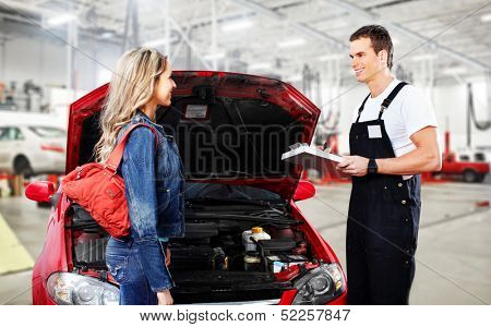 Car mechanic in uniform. Auto repair service.