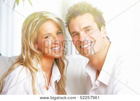 Happy couple at home. Mortgage and insurance concept.