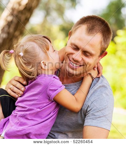 Tender Family Scene In Park
