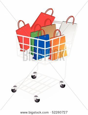 Colorful Paper Shopping Bags In Shopping Cart