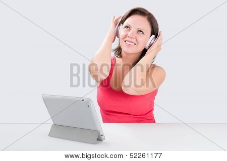 Smiling Young Woman Is Listening To Music