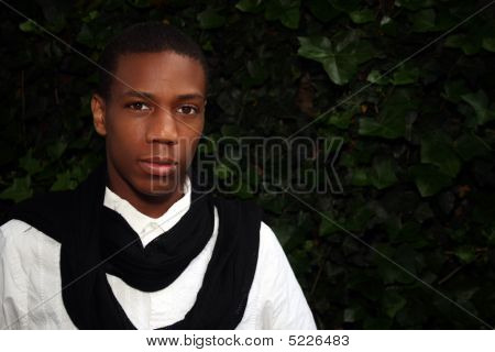 Man In Front Of Ivy Wall