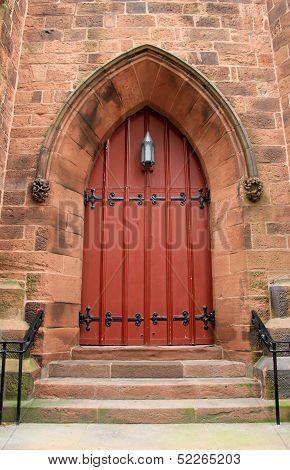 Big red door in old brick church