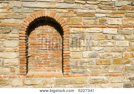 Old Stone Wall With A Brick Niche