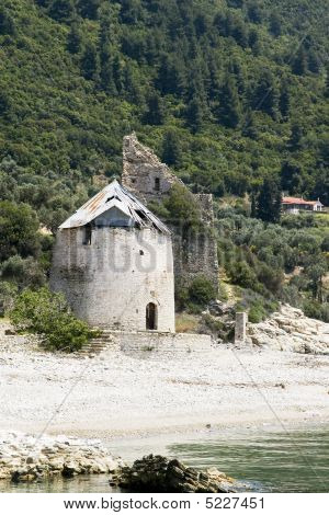 Old Destroyed Mill And Venetian Sentry Serf Tower On Coast