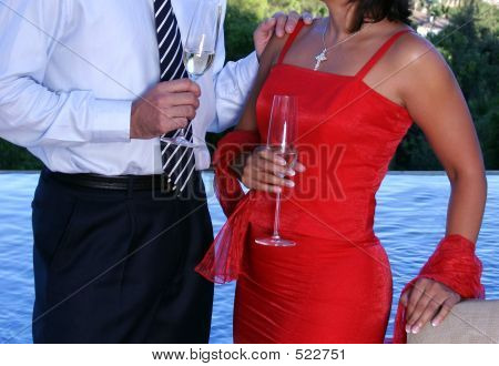 Couple Chatting Over Champage At A Dinner Party