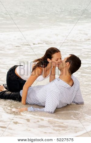Beautiful Couple Kissing In The Tide