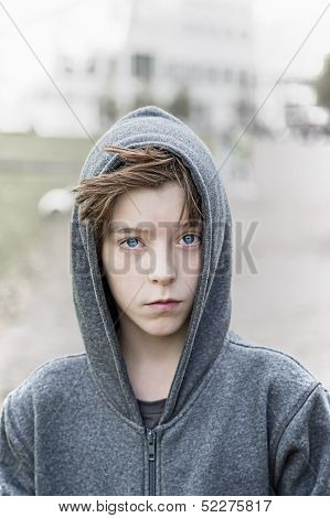 Portrait Of A Teenage Boy With Grey Hoodie Sweatshirts