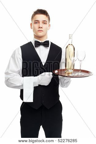 Young Serious Waiter With Bottle Of Wine On Tray