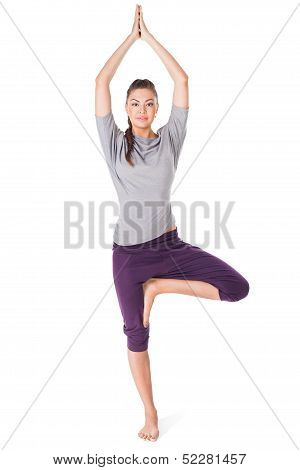 Young Woman Doing Yoga Exercise Tree-pose Isolated On White