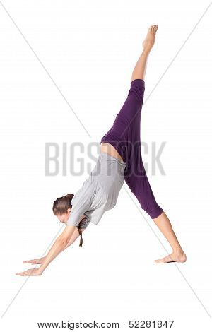 Young Woman Doing Yoga Exercise Downward-facing Dog
