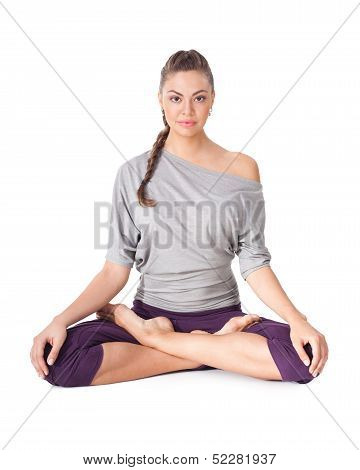 Young Woman Doing Yoga Exercise Padmasana (lotus Pose).