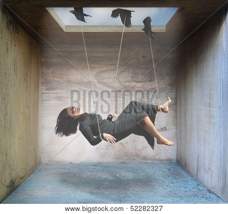 a woman being carried by birds in a box