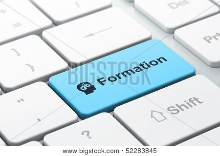 Education concept: Head With Gears and Formation on computer key