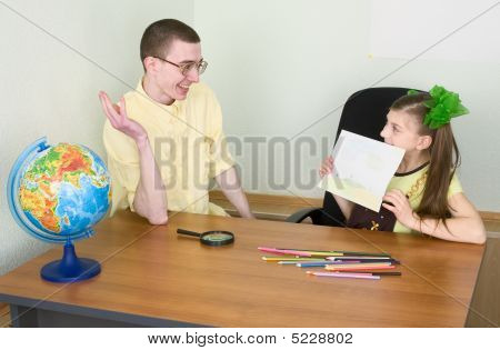 Girl Shows New Drawing To The Brother