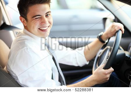Man in car winking eye