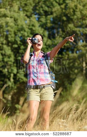 Woman Taking Photo In Nature