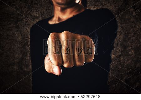 Love Tattoo. Hand With Clenched Fist