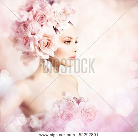 Fashion Beauty Model Girl with Flowers Hair. Bride. Perfect Creative Make up and Hair Style. Hairstyle. Bouquet of Beautiful Flowers.