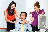 Asian colleague or manager or boss having  an office affair or flirting with two secretary or employ