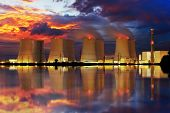 stock photo of reactor  - Nuclear power plant by night with reflection in water - JPG