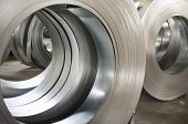 foto of tin man  - sheet tin metal rolls in production hall - JPG