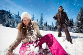 picture of snowball-fight  - Young couple playing in snow - JPG