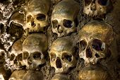 stock photo of epidemic  - Wall full of skulls and bones in the bone chapel in Evora - JPG