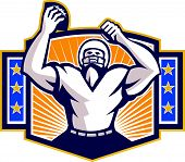 foto of scat  - Illustration of an american football gridiron wide receiver running back player celebrating a touchdown facing front set inside shield crest with stars and sunburst done in retro style on isolated background - JPG