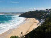 pic of st ives  - Carbis Bay Cornwall England near St Ives and on the South West Coast Path with a sandy beach and blue sky on a beautiful blue sky sunny day - JPG