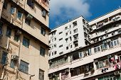picture of overpopulation  - Overpopulated residential building in Hong Kong - JPG