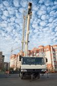 picture of boom-truck  - Mobile crane truck and blue sky at construction background - JPG