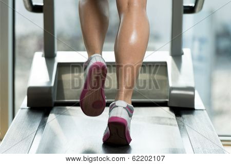Woman Feet On Treadmill