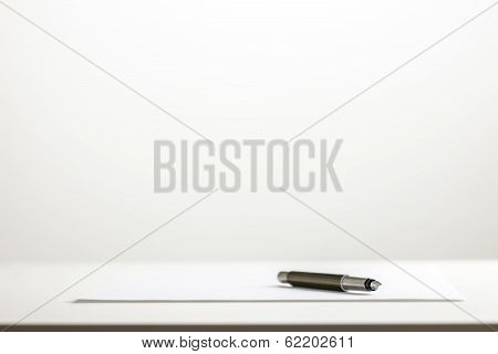 Pen On A Sheet Of Blank White Paper