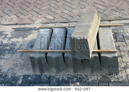 pile of concrete curbstones