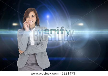 The word verify and smiling thoughtful businesswoman against futuristic black background with circles