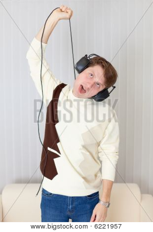 Young Man Smothers Itself Wire From Stereo-ear-phones