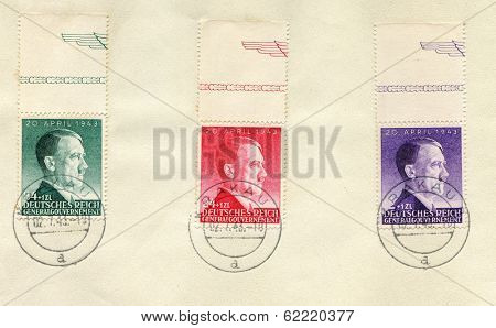 GERMANY - JULY 2, 1943: 3 German stamps - sheet - show portrait of Adolf Hitler, canceled in Krakow during nazi occupation